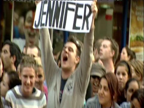 tilt up fan holding 'i love jennifer' banner at london premiere of 'the break up' 14 june 2006 - obsessive stock videos & royalty-free footage