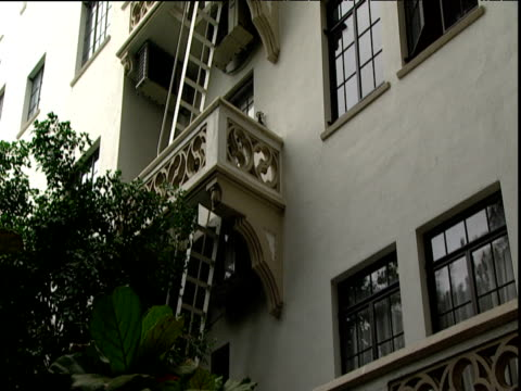 Tilt up fire escape ladders and balconies on side of Hotel Chateau Marmont Sunset Strip Los Angeles