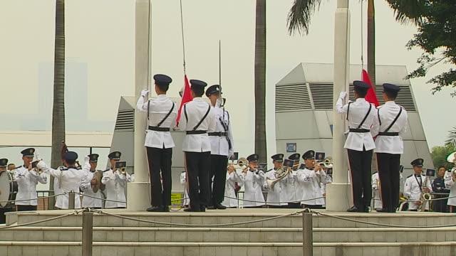 tilt up flag hoisting hong kong china - hoisting stock videos & royalty-free footage