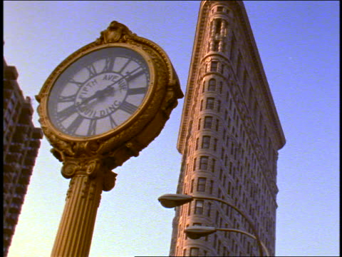 tilt up flatiron building + 5th avenue clock / new york city - flatiron building manhattan stock videos and b-roll footage