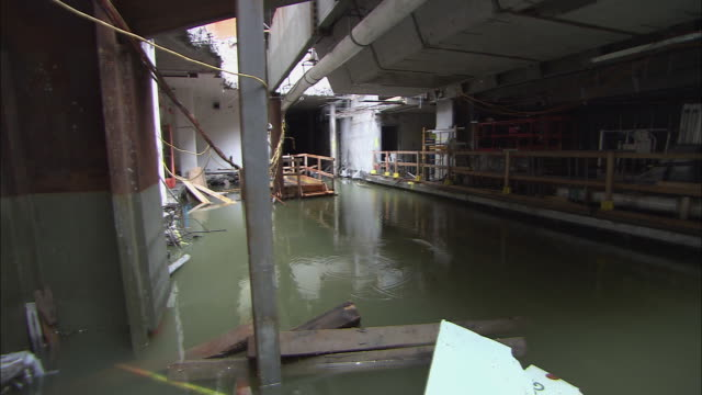 tilt up flooded interior of path train station ls flooded interior of station with debris - environment or natural disaster or climate change or earthquake or hurricane or extreme weather or oil spill or volcano or tornado or flooding stock videos & royalty-free footage