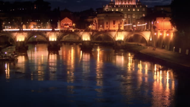 tilt up footage of ponte sant'angelo and dome of st. peter's basilica - vatikanstaat stock-videos und b-roll-filmmaterial