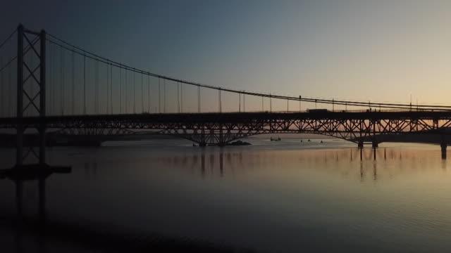 tilt up forth bridge at sunrise - romantic sky stock videos & royalty-free footage