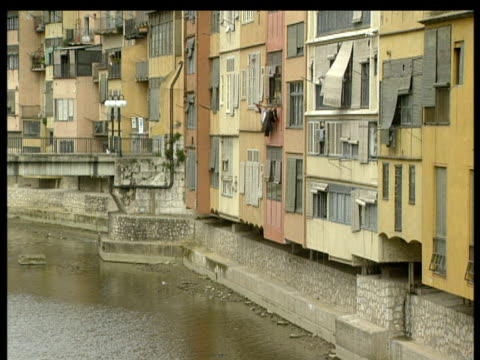 tilt up from apartments that lines river to spire of cathedral gerona costa brava - spire stock videos & royalty-free footage