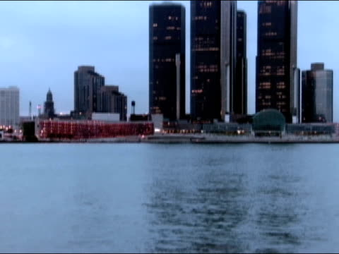 tilt up from detroit river to view of downtown skyline / detroit, michigan - detroit river stock-videos und b-roll-filmmaterial
