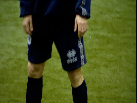tilt up from feet of boudewijn zenden to face concentrating on ball during middlesbrough fc indoor training session middlesbrough 01 jan 04 - middlesbrough stock videos and b-roll footage