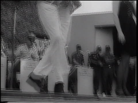 tilt up from feet to bob hope dancing wackily on stage at uso show / vietnam war / newsreel - bob hope komiker stock-videos und b-roll-filmmaterial