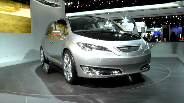 stockvideo's en b-roll-footage met tilt up from ms of floor sign to ws of car on turntable chrysler 700c concept car at 2012 naias at cobo hall on january 18 2012 in detroit michigan - chrysler