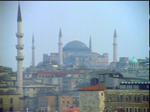 tilt up pan from fountain to two mosques (hagia sofia on right, yeni mosque on left) / istanbul - yeni cami mosque stock videos and b-roll footage