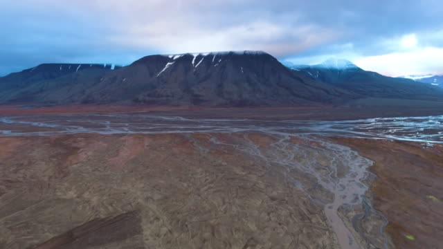 tilt up from ground to arctic circle mountain range, aerial - svalbard islands stock videos & royalty-free footage
