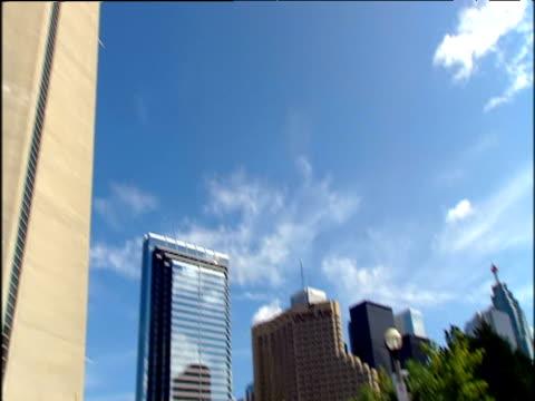 Tilt up from harbour to CN tower under blue sky