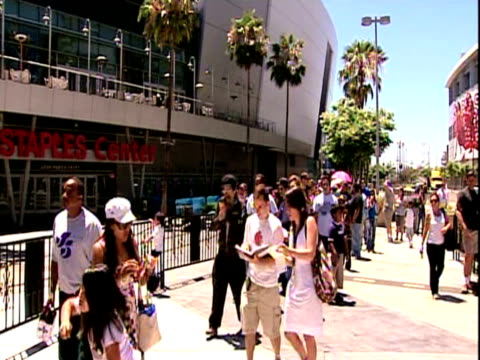 Tilt up from large crowd waiting in line to top of Staples Center ahead of Michael Jackson memorial concert Los Angeles; 7 July 2009
