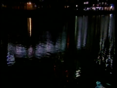 tilt up from lights reflected in thames to canary wharf london - rippled stock videos & royalty-free footage