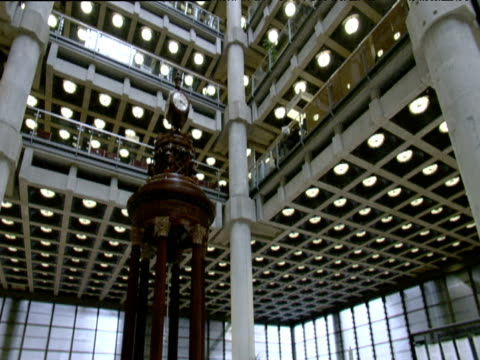 Tilt up from Lutine Bell to vast atrium of Lloyds of London building