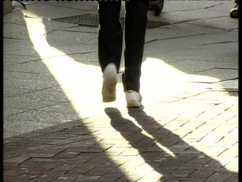 tilt up from pedestrians feet walking in busy street to woman falkirk - pedestrian walkway stock videos & royalty-free footage