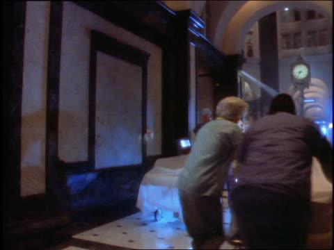 vídeos y material grabado en eventos de stock de tilt up from people and stretchers in hallway to maternity sign - sección hospitalaria