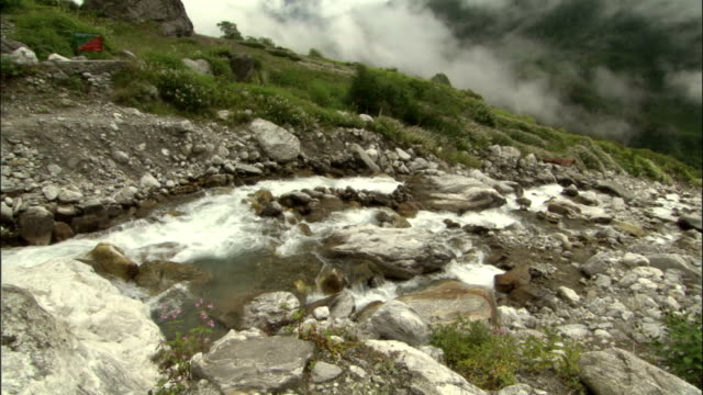tilt up from river to blowing clouds available in hd. - valley stock videos & royalty-free footage
