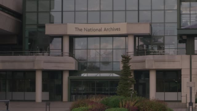 tilt up from water to entrance of national archives - bbc archives stock-videos und b-roll-filmmaterial