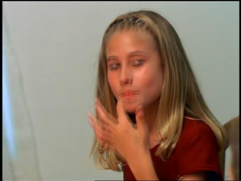 stockvideo's en b-roll-footage met tilt up pan girl eating whipped cream + putting it on boy's nose at table / thanksgiving - menselijke neus