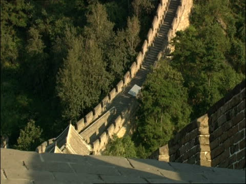 tilt up hill along great wall of china, mutianyu, china - mutianyu stock videos & royalty-free footage