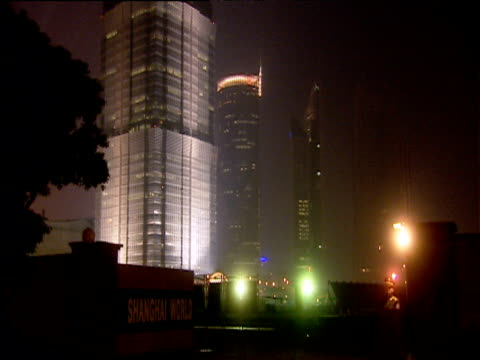 tilt up illuminated jin mao tower at night shanghai - jin mao tower stock videos & royalty-free footage