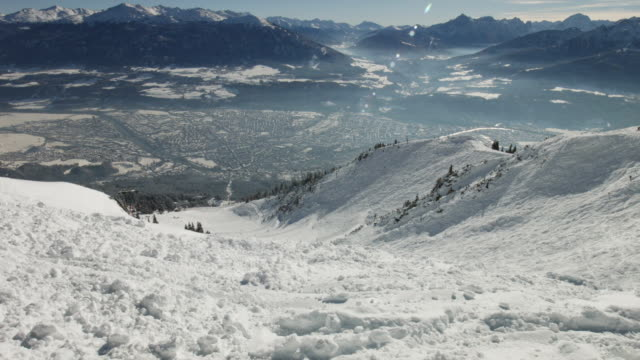 tilt up: innsbruck in winter, as seen from seegrube - brennero stock videos and b-roll footage