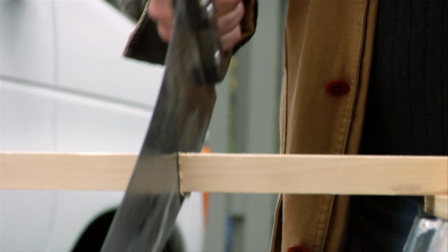 tilt up man sawing plank / smiling at camera - lexington massachusetts stock videos & royalty-free footage