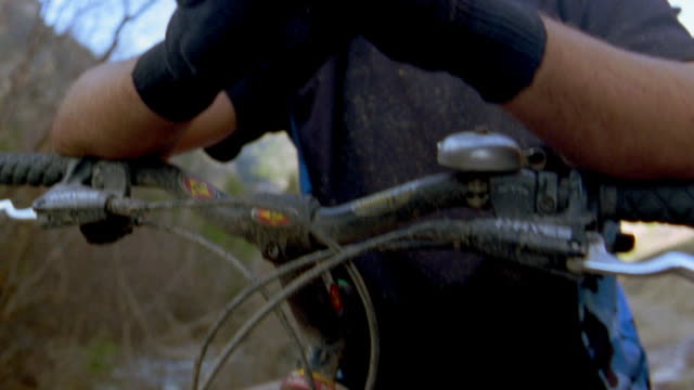 tilt up man sitting on mountain bike w/hands crossed / close up of face / man smiling - mountain biking stock videos & royalty-free footage