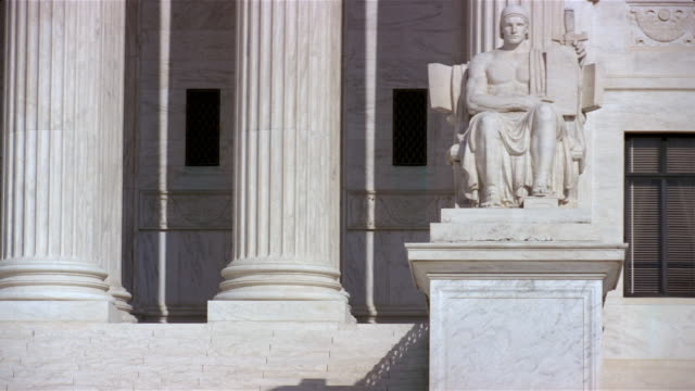tilt up marble figure 'guardian or authority of law' and columns at entrance to us supreme court building / washington, dc - us supreme court building stock videos and b-roll footage