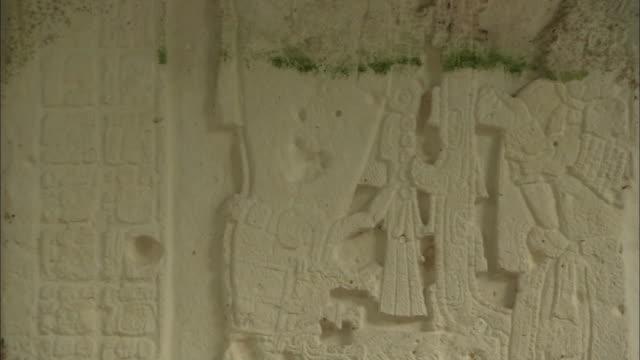 tilt up cu mayan reliefs - pre columbian stock videos & royalty-free footage