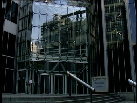 tilt up modern office buildings from steps and entrance - fensterfront stock-videos und b-roll-filmmaterial