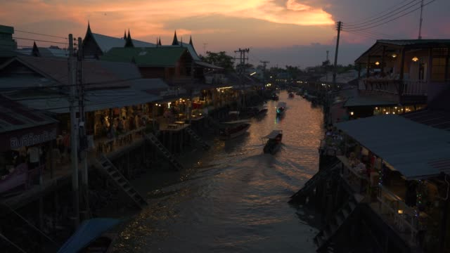 tilt up of amphawa floating market in twilight time. - floating market stock videos & royalty-free footage