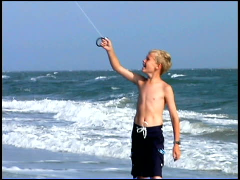 tilt up of boy flying kite - see other clips from this shoot 1335 stock videos and b-roll footage
