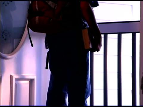 vidéos et rushes de tilt up of boy leaving home with backpack - sac à dos