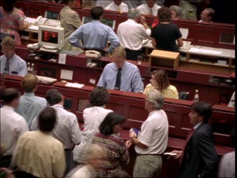 tilt up of crowd on floor of frankfurt stock exchange / germany - frankfurt stock exchange stock videos and b-roll footage