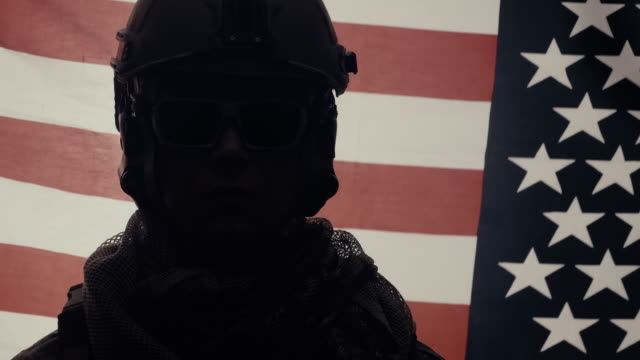 tilt up of soldier with usa flag in background. - military recruit stock videos & royalty-free footage