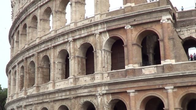 Tilt up of the side of the Colosseum in Rome Italy from outside