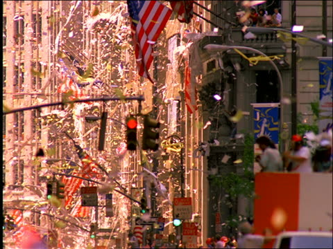 tilt up of ticker tape and paper falling from building / parade / operation welcome home / nyc - ticker tape stock videos and b-roll footage