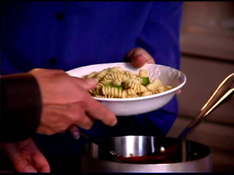 tilt up of woman serving pasta - savoury sauce stock videos & royalty-free footage