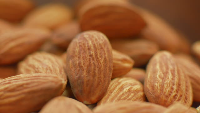 Tilt up on bowl filled with whole almonds