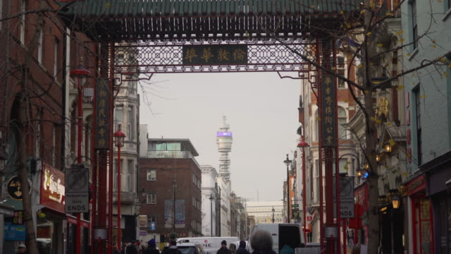 tilt up one of the decorative gates surrounding london's chinatown district. - telecommunications equipment stock videos & royalty-free footage