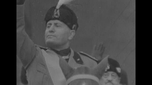 tilt up ornate cross at top of exterior gable of church / italian prime minister benito mussolini wearing hat with plume just above forehead /... - benito mussolini stock videos & royalty-free footage