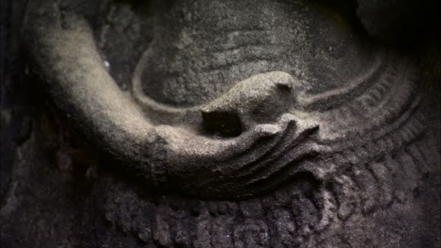 tilt up over carving of devata, angkor. - relief carving stock videos & royalty-free footage