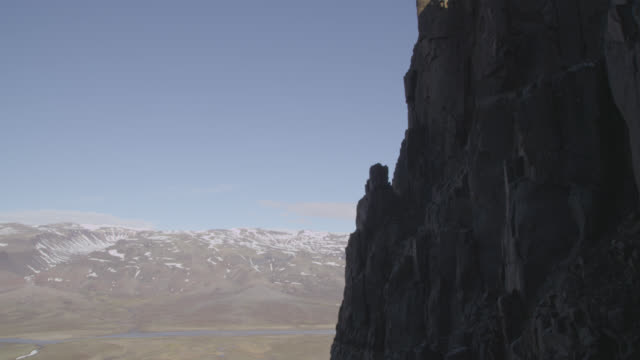 Tilt up over cliff face and precipice, Greenland