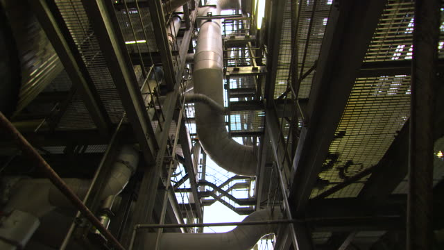 tilt up over equipment in sugar refinery, uk - manufacturing machinery stock videos & royalty-free footage