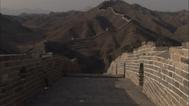 tilt up over great wall of china at badaling, beijing. - great wall of china stock videos & royalty-free footage