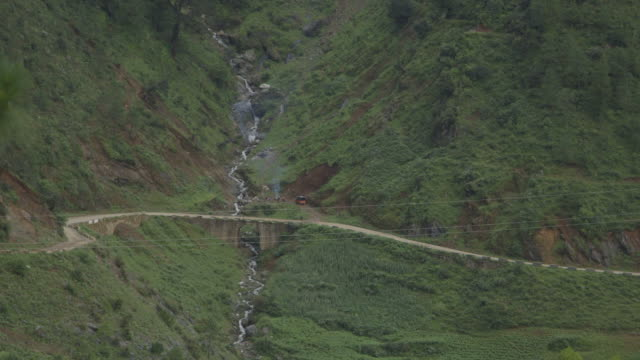 tilt up over himalayan valley and bridge, high angle wide-shot - valley stock videos & royalty-free footage