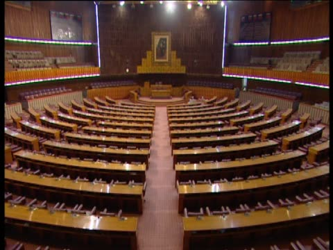 tilt up over the interior of the national assembly of pakistan - parliament building stock videos & royalty-free footage