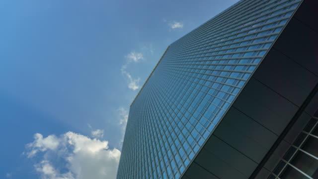 4k tilt up , pedestal up ,time lapse office building and sky . - tilt up stock videos & royalty-free footage