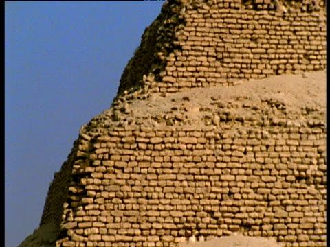 tilt up pyramid djoser against blue sky saqqara - saqqara stock videos and b-roll footage